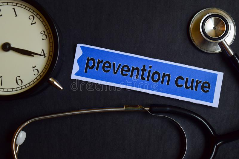 Prevention cure on the print paper with Healthcare Concept Inspiration. alarm clock, Black stethoscope. stock photos
