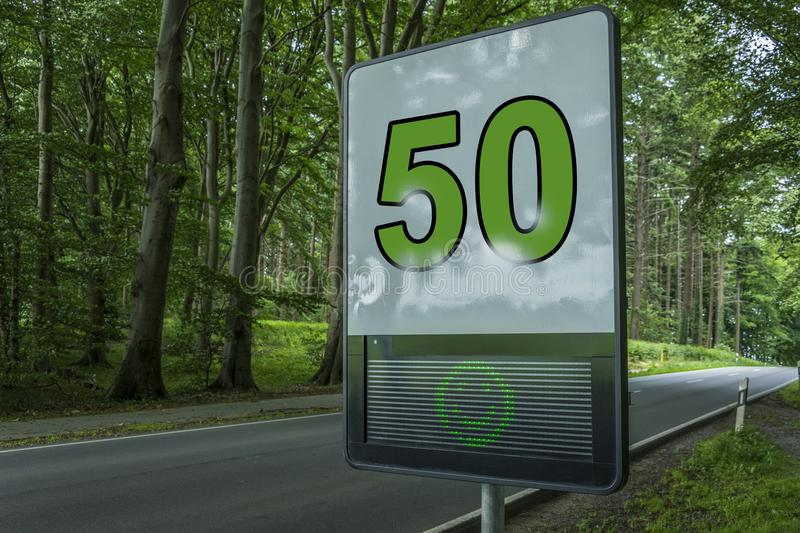 Prevention radar, speed limit detection device, digital alert sign - It shows green happy face and speed limit 50 on a street royalty free stock photos
