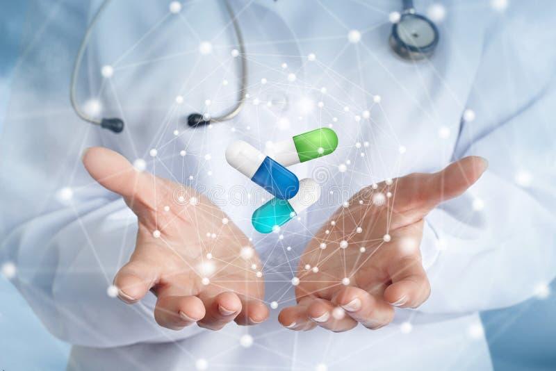 Preventivpillerar i händerna för doktors` s arkivbilder