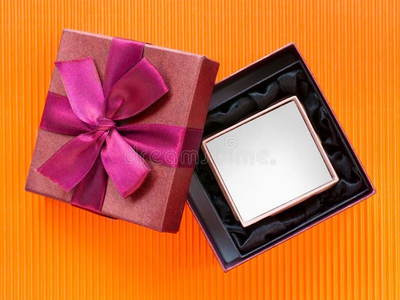 Prezentów pudełka na pomarańczowym kartonie obraz stock