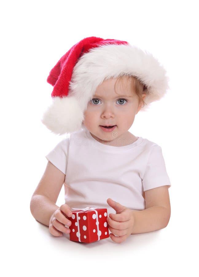 prezent pudełkowata dziewczyna kapeluszowy mały czerwony Santa fotografia royalty free