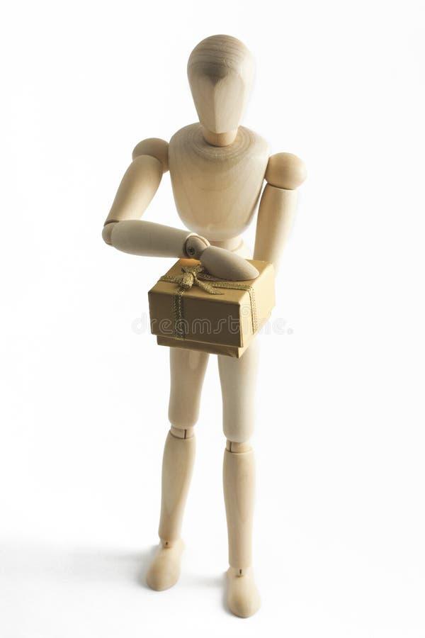 prezent wręcza mannequin drewnianego zdjęcie royalty free