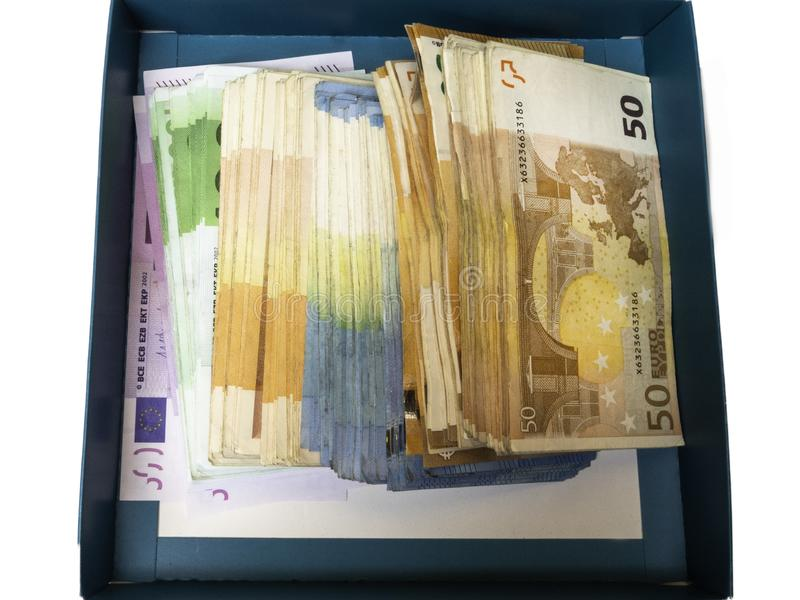 Prezenta pudełko z pieniądze odizolowywającym na białym tle zdjęcie stock