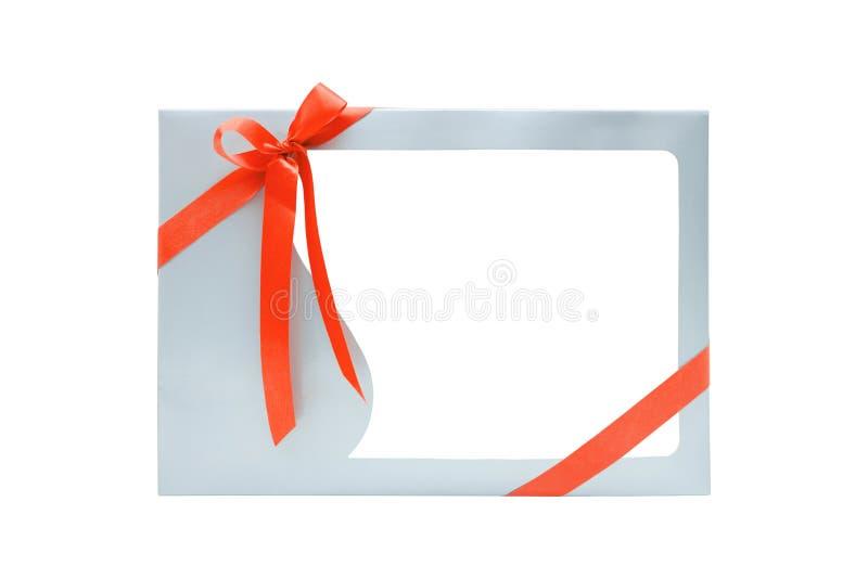 Prezenta pudełko z tasiemkowym łękiem wiążącym z puste miejsce ramą dla produktu pokazu, odosobnioną na białym tle obraz royalty free
