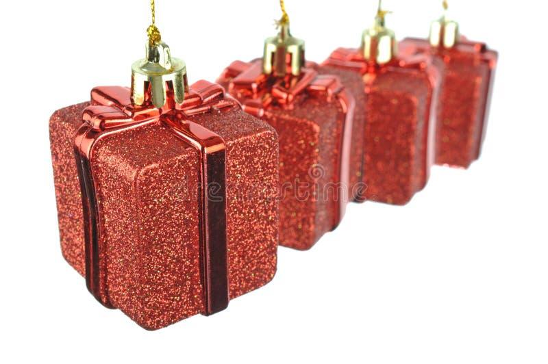 Prezenta wiszący czerwony pudełko zdjęcia royalty free
