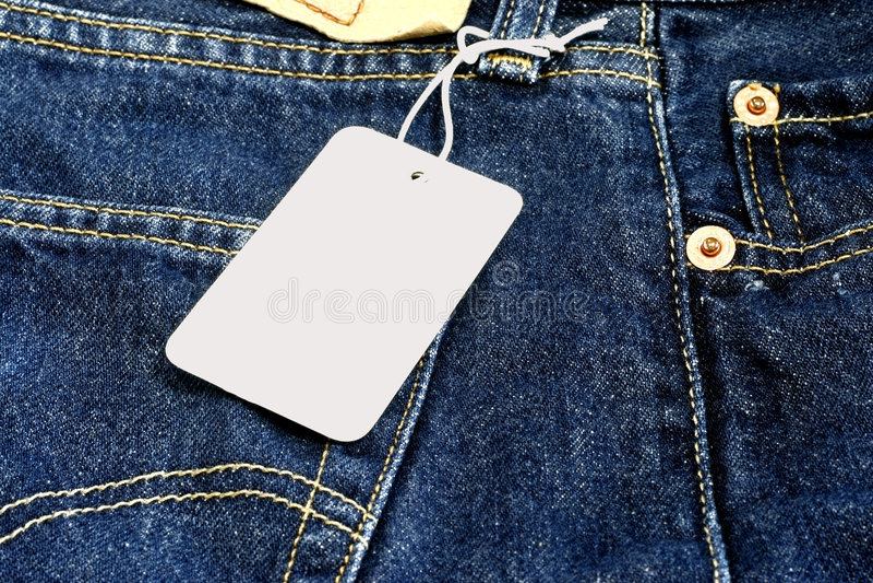 Prezzo da pagare in bianco sulle blue jeans fotografia stock libera da diritti