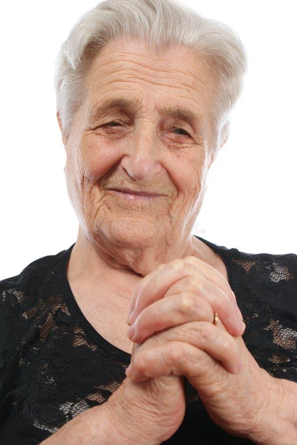 Prière de dame âgée image stock
