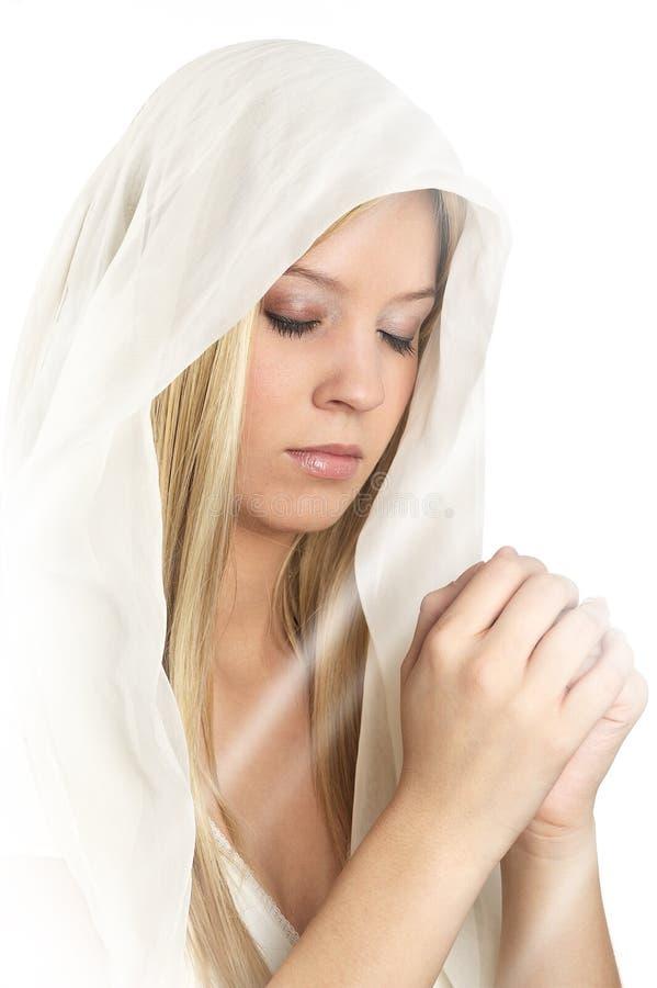 Prière de femmes sur le fond blanc photos libres de droits