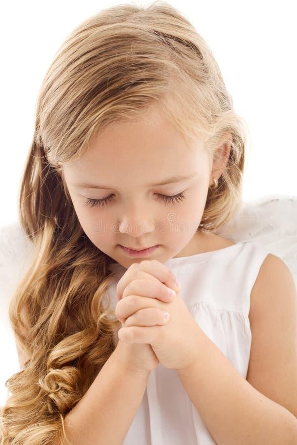 Prière de petite fille photo libre de droits