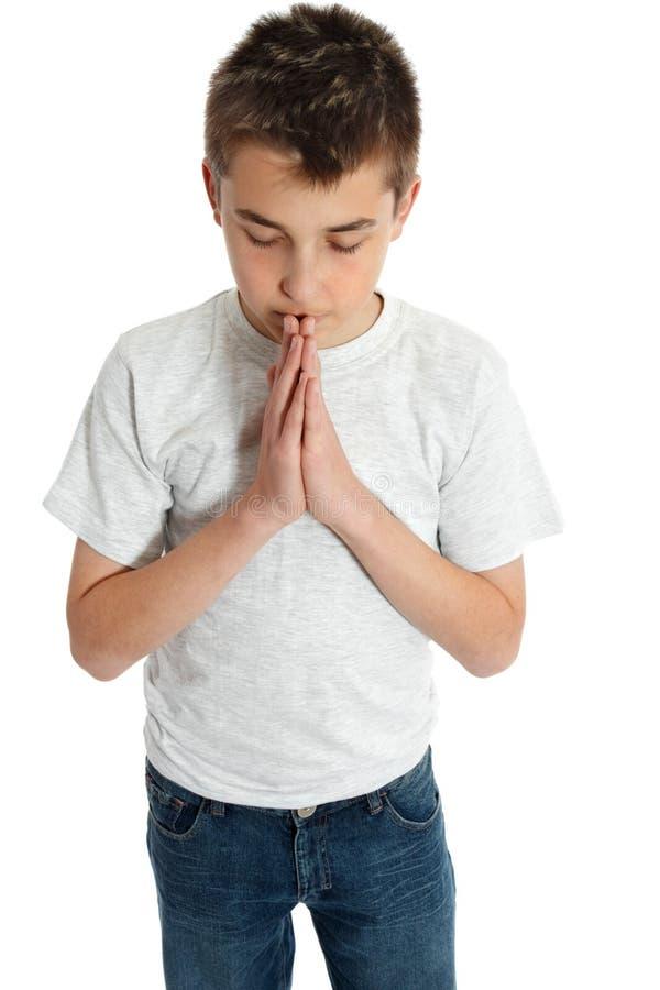 Prière spirituelle de garçon photos stock
