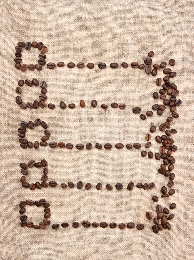 price- list from coffee beans on the canvas stock photo
