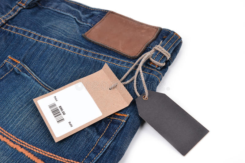 Price tag with barcode on jeans stock photography