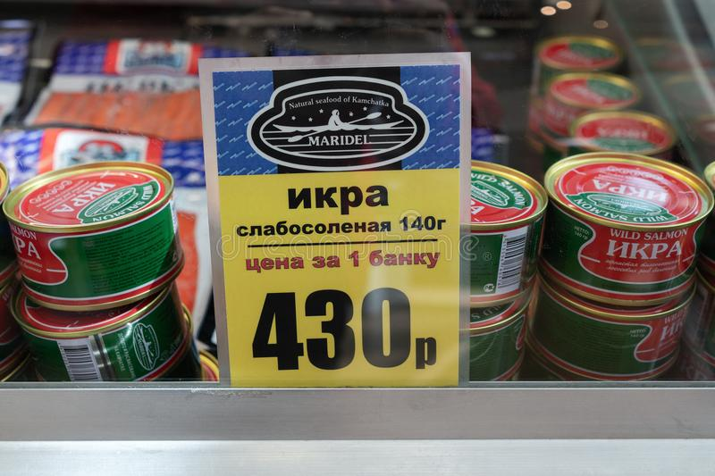 Price tag for canned salted red caviar wild sockeye salmon in fish market stock images