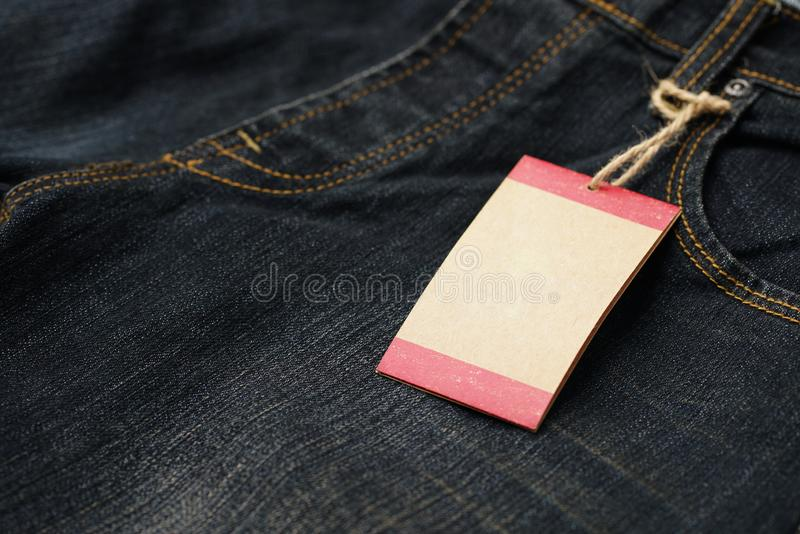 Price tag or Empty paper tag ,blank cardboard price with string on jean.  stock photo