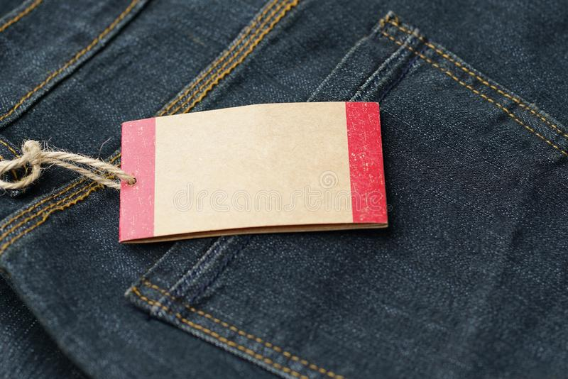 Price tag or Empty paper tag ,blank cardboard price with string on jean.  royalty free stock photos
