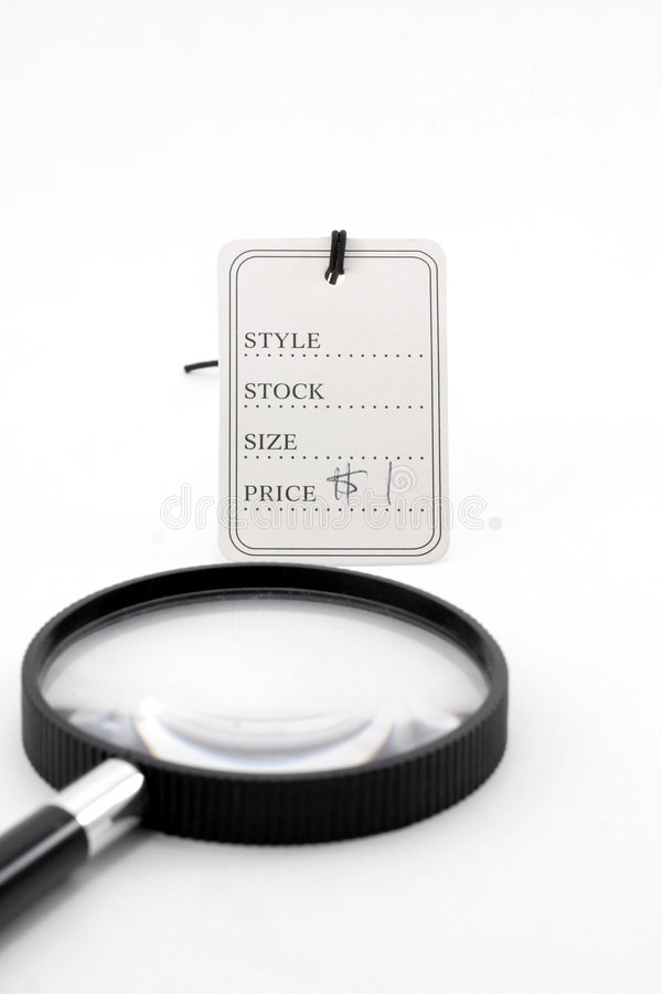 Price Tag And Magnifier Royalty Free Stock Image