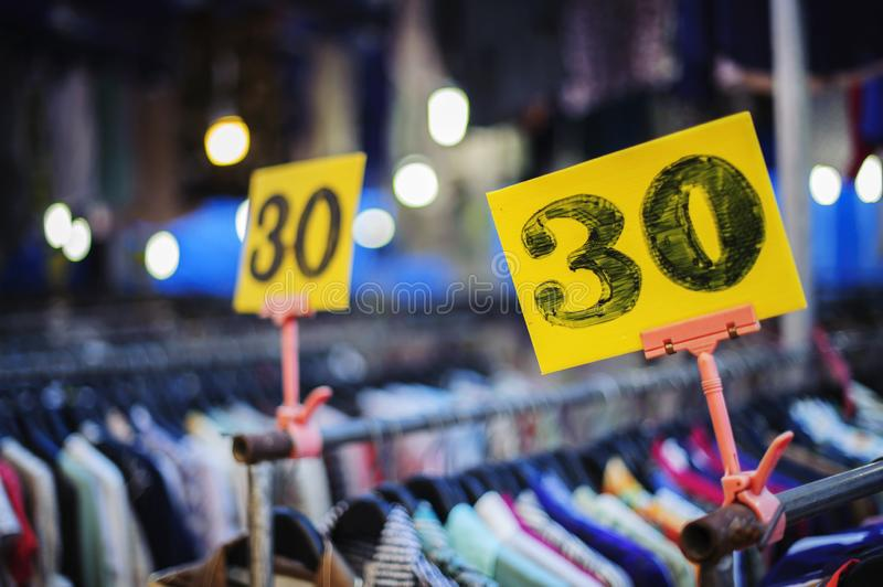 The price tag of 30 shirts on the rail royalty free stock photo