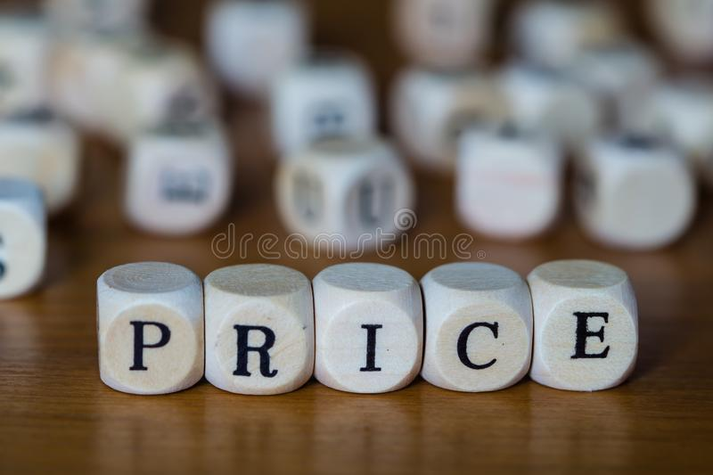 Price written with wooden cubes stock photos
