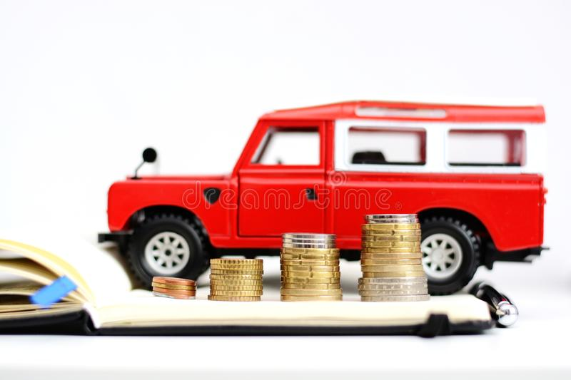 Prices or sales evolution in automotive industry red land vehicle near pile of money stock image