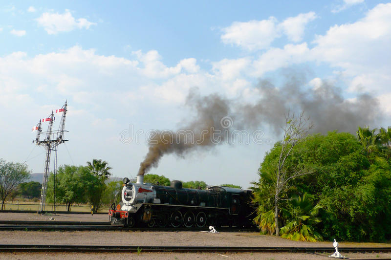Pride of Africa train about to depart from Capital Park Station in Pretoria, South Africa. PRETORIA, SOUTH AFRICA- SEPTEMBER 9: Steam train about to depart from royalty free stock photography