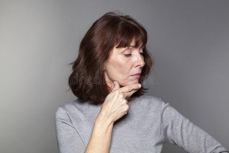 Pride and arrogance for offended beautiful mature woman royalty free stock images