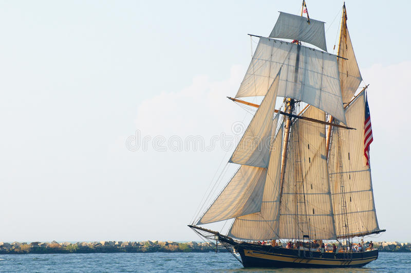 Pride of Baltimore. The topsail schooner Pride of Baltimore II sails into the evening sun in the Parade of Ships that began the 2010 Cleveland Tall Ships royalty free stock photography