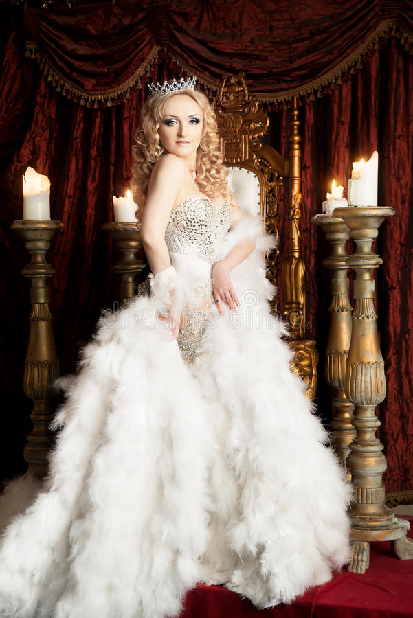 Pride gorgeous queen with crown and throne. Palace. Pride gorgeous queen with crown and throne royalty free stock photos