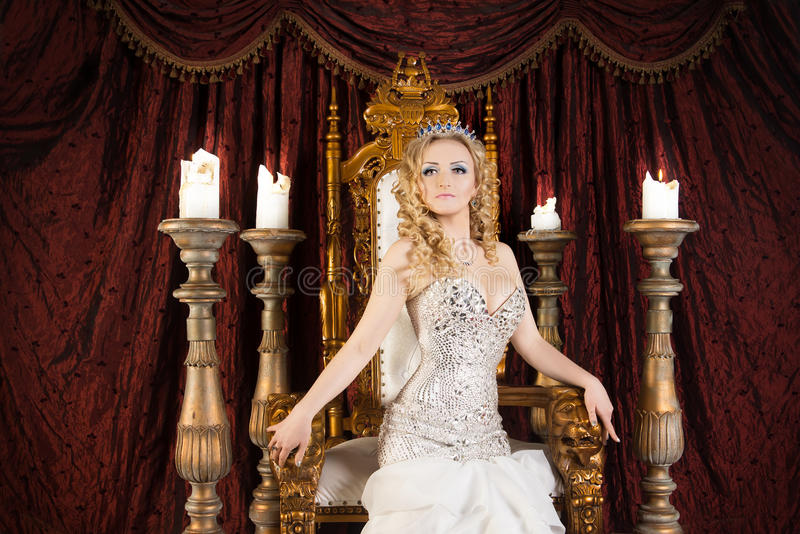 Pride gorgeous queen with crown and throne. Palace. Pride gorgeous queen with crown and throne royalty free stock photography