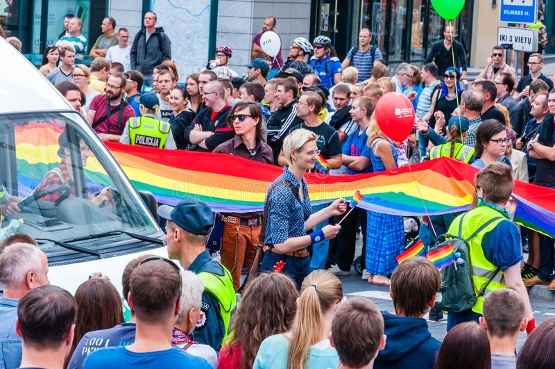 Pride parade in action. Crowd of watchers and demonstrators with rainbow flags. Event celebrating lesbian, gay, bisexual,. Vilnius, Lithuania - July 27, 2013 stock images