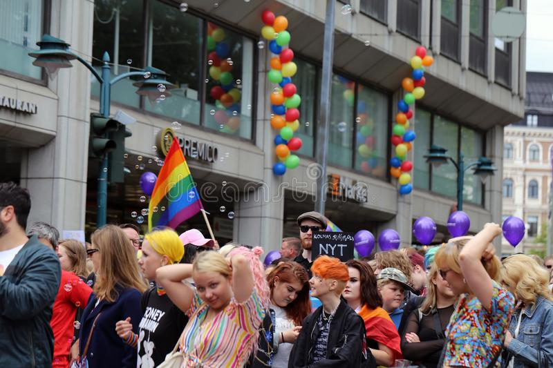 Pride Parade of Helsinki 2019: Rainbow Colored Flags and Accessories. Pride parade of Helsinki, Finland, June 2019. People marching for equality, acceptance and royalty free stock images