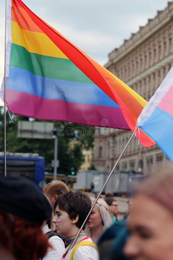 Pride Parade of Helsinki 2019: Rainbow Colored Flags and Accessories. Pride parade of Helsinki, Finland, June 2019. People marching for equality, acceptance and stock images