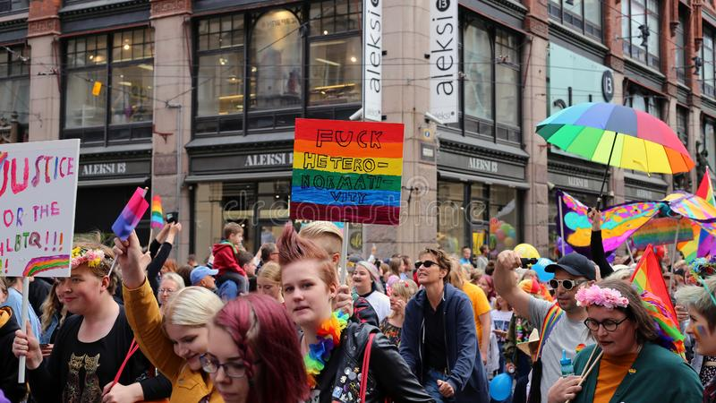 Pride Parade of Helsinki 2019: Rainbow Colored Flags and Accessories. Pride parade of Helsinki, Finland, June 2019. People marching for equality, acceptance and royalty free stock photo