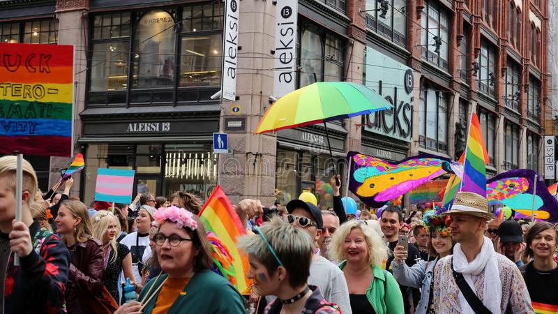 Pride Parade of Helsinki 2019: Rainbow Colored Flags and Accessories. Pride parade of Helsinki, Finland, June 2019. People marching for equality, acceptance and stock image