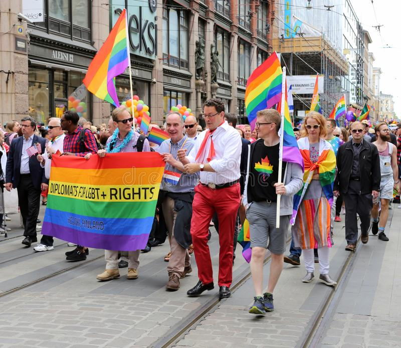Pride Parade of Helsinki 2019: Rainbow Colored Flags and Accessories. Pride parade of Helsinki, Finland, June 2019. People marching for equality, acceptance and stock photos