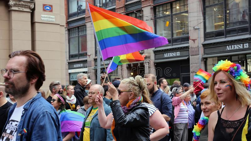 Pride Parade of Helsinki 2019: Rainbow Colored Flags and Accessories. Pride parade of Helsinki, Finland, June 2019. People marching for equality, acceptance and royalty free stock photography