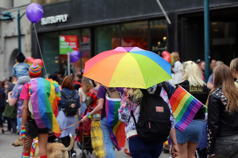 Pride Parade of Helsinki 2019: Rainbow Colored Flags and Accessories. Pride parade of Helsinki, Finland, June 2019. People marching for equality, acceptance and royalty free stock photos