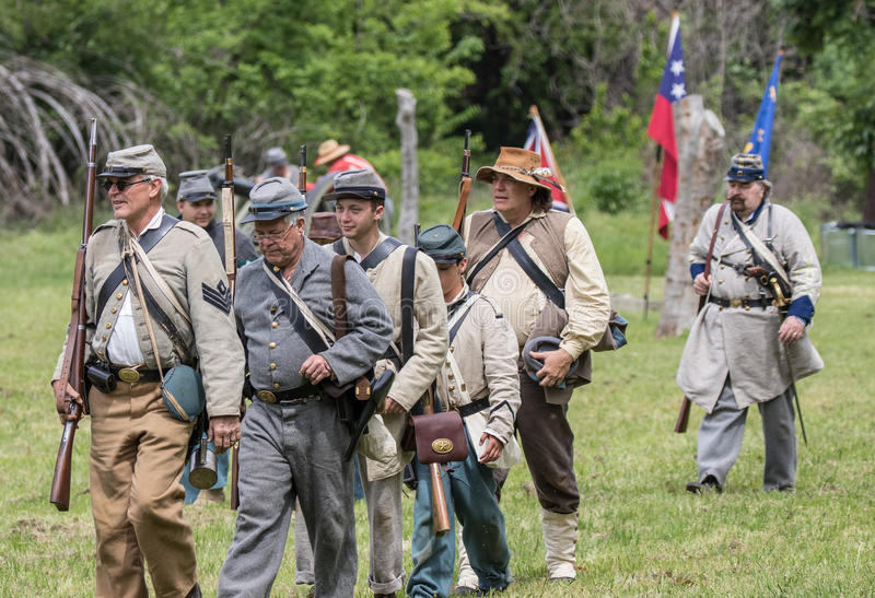 The Pride of the South. Civil War era soldiers move up to the fighting lines at the Dog Island reenactment in Red Bluff, California stock photos