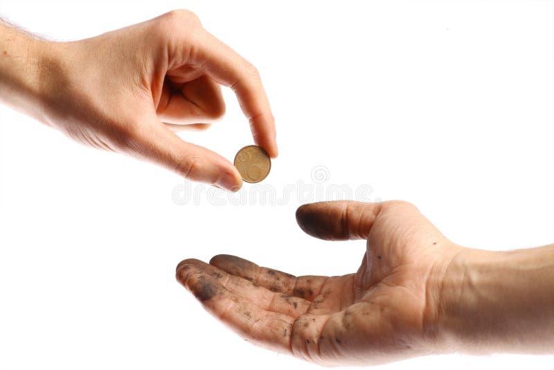 Prier pour une pièce de monnaie images libres de droits