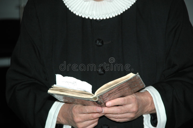 Priest and bible stock photography