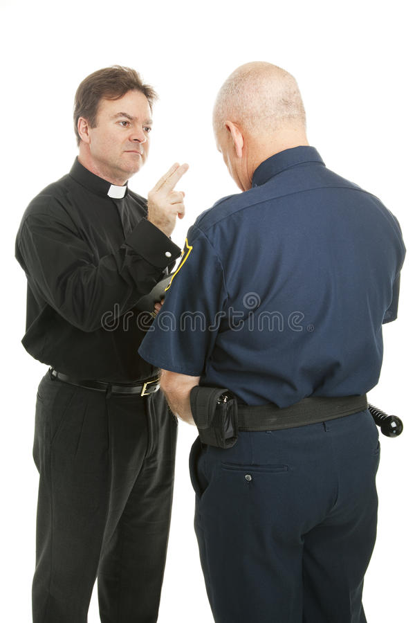 Priest Blesses Policeman. Policeman receives a blessing from a priest or minister. Isolated on white royalty free stock images