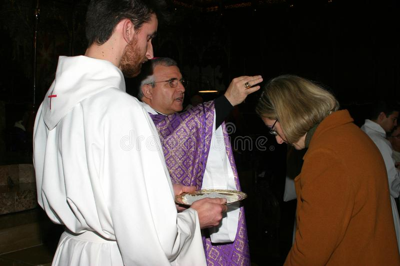 Priest blessing at Palma de Mallorca cathedral royalty free stock photos