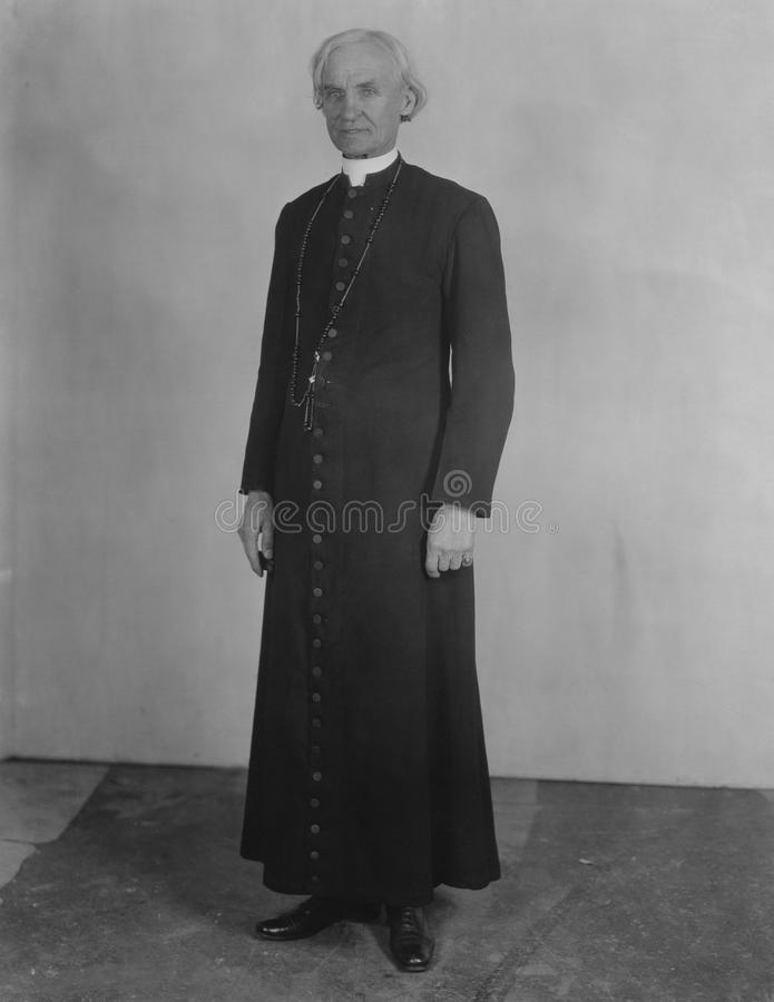 Priest in cassock stock images