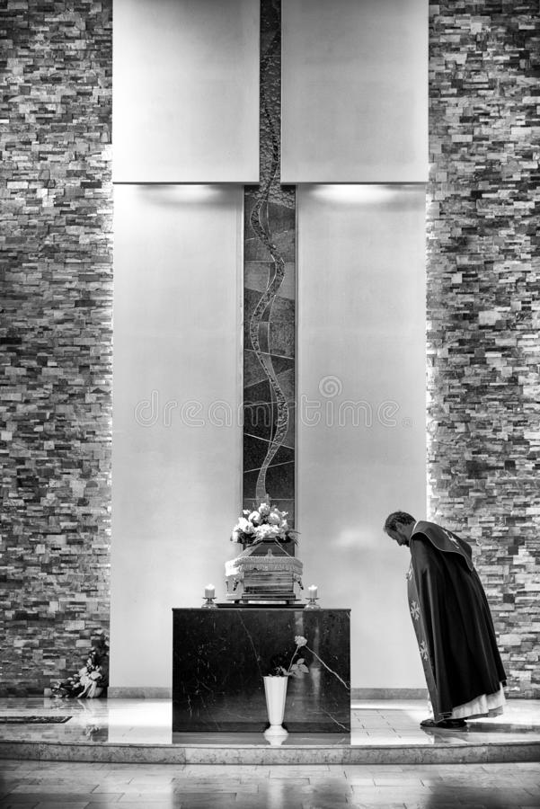 Priest and coffin at mourning ceremony royalty free stock images