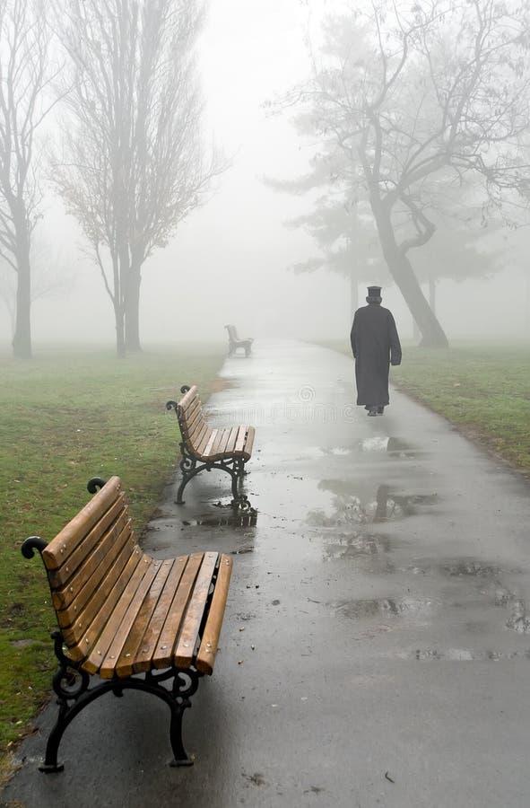 Priest in fog