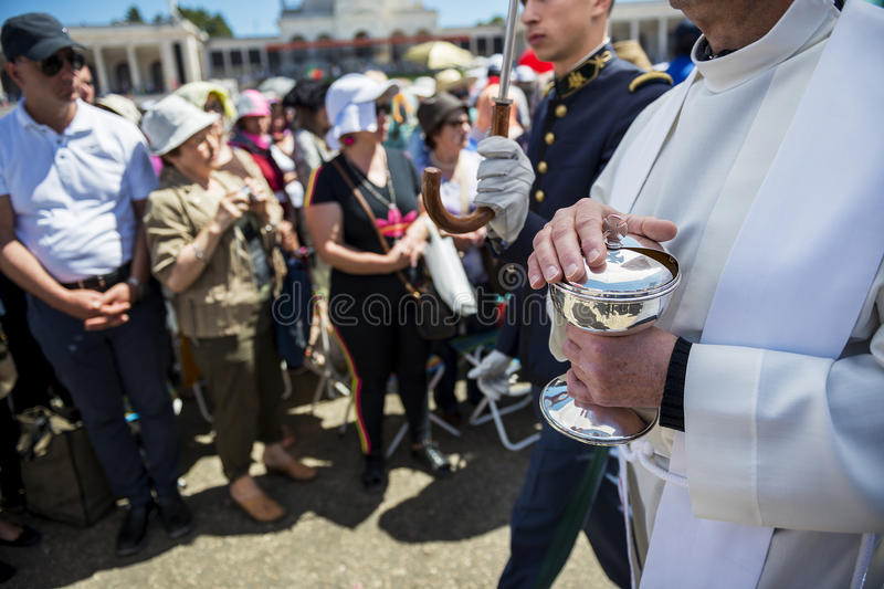 Priest holding a ciborium with sacramental bread at the Sanctuary of Fatima during the celebrations of the apparition of the Virgi. Fatima, Portugal - May 13 stock photo
