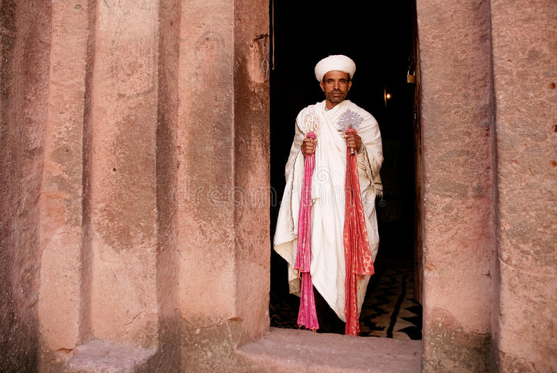 Priest holding cross at church lalibella ethiopia africa royalty free stock photos