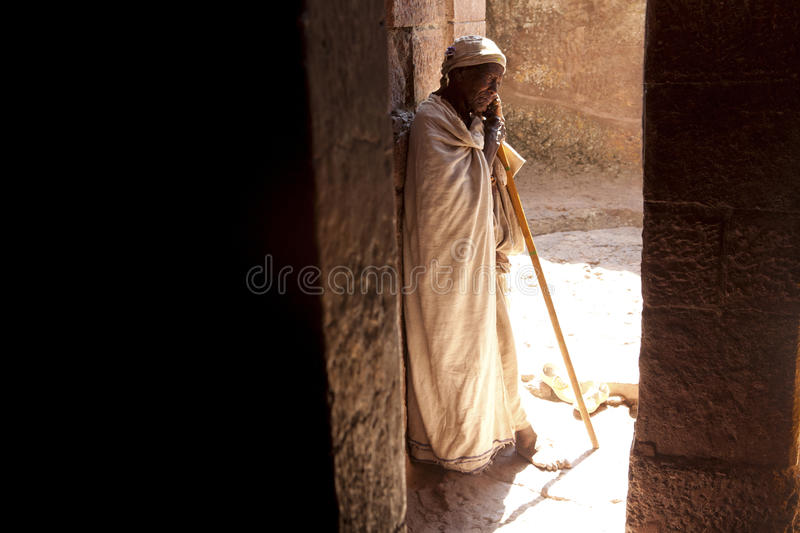 A Priest in Lalibela. A Priest stood in a doorway of a monolithic church, Lalibela stock image
