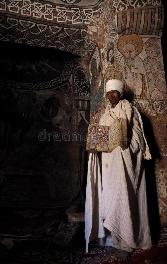 Free Priest Opens An Illustrated Bible Inside A Church In Ethiopia. Royalty Free Stock Images - 112118329