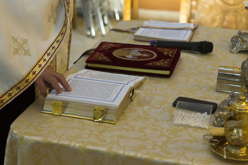 Priest reading from the Bible stock photography