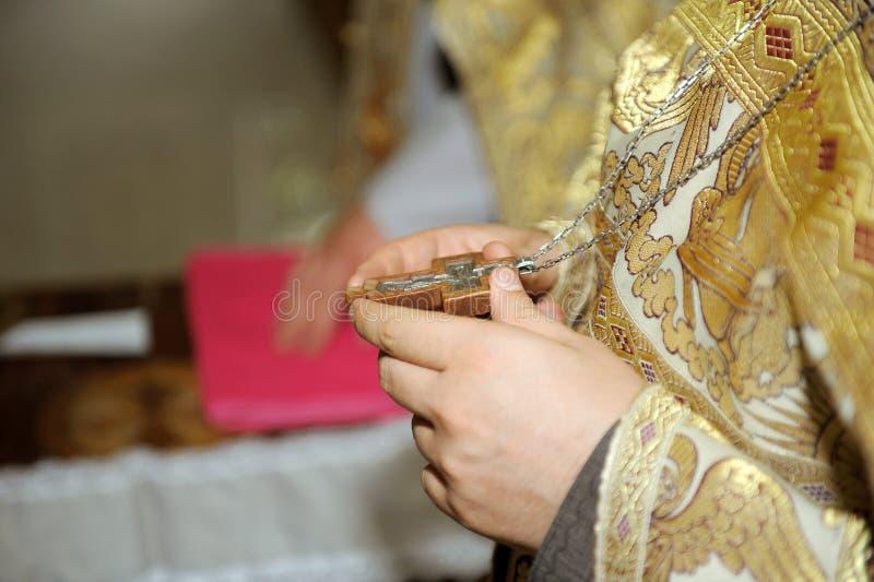 Wooden Cross on Priest stock image